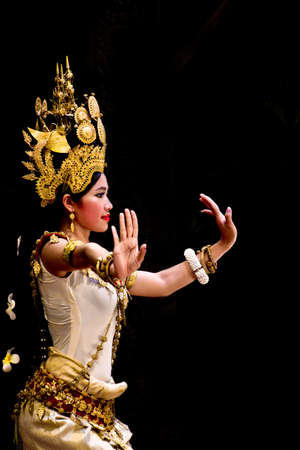 SIEM REAP, CAMBODIA - May 2012  A traditional Khmer Cambodian female dancer in Apsara dance pose against black