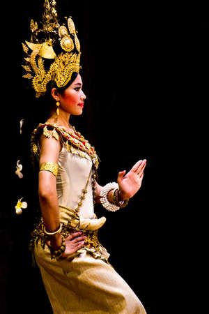 SIEM REAP, CAMBODIA -May 2012  A traditional Khmer Cambodian female dancer in Apsara dance pose against black