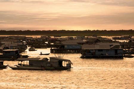 tonle sap: Sunset shot of Floating Village at Tonle Sap Lake- Cambodia