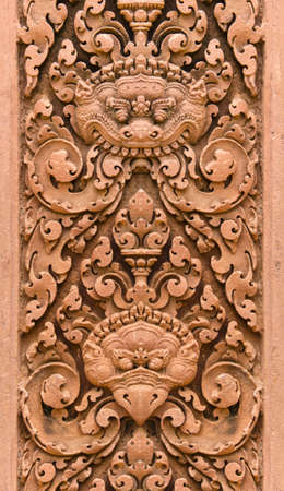 khmer: Seamless tile of Bird and Lion wall stone carvings at Banteay Srei temple, Angkor