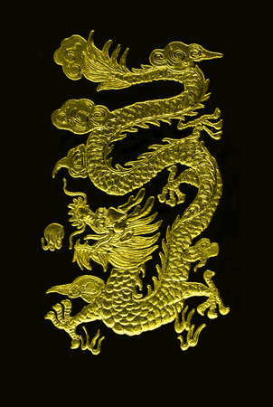 A golden dragon caving with black background