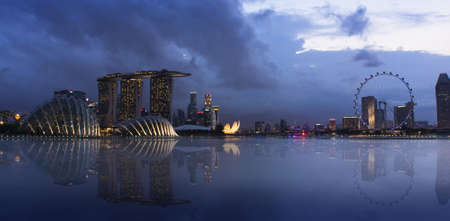 An evening shot of Singapore lighted cityscape