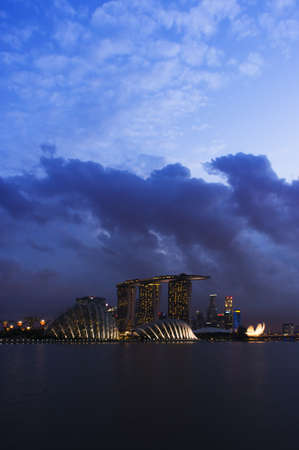 Vertical shot of Singapore Skyline in the evening with Dramatic lighting