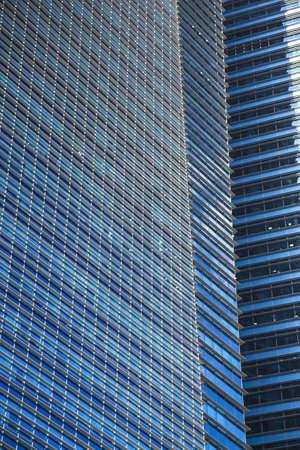 Close up of a modern blue glass building photo