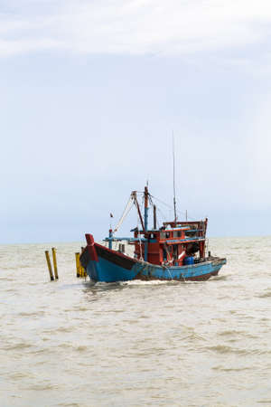 Chinese wooden Fishing boat near harbour photo