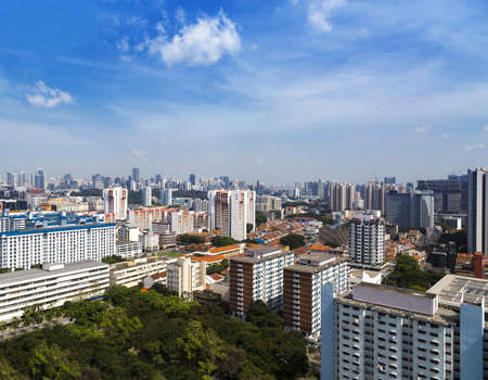 High angle view of a cluster of colourful flats in residential District next to a park- Singapore photo