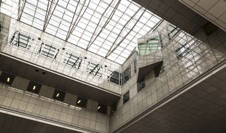 tall buildings: A high angle show of a glass ceiling in an office building. Editorial