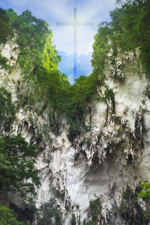 appear: An illusional Christian Cross appear on a mountain cliff.