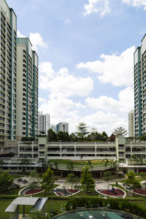 hdb: Vertical shot of a residential estate with carparks and playground