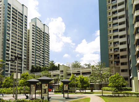 block of flats: A new apartment neighborhood with carpark and playground