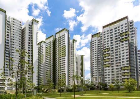 block of flats: A horizontal shot of a park leading to a green estate in Singapore