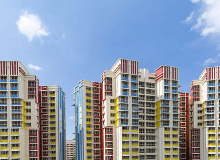 A group of high rise colorful residential apartments