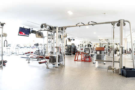 weight machine: An interior shot of a club gym with all the execrise equipments