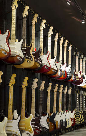 A wall of Electric Guitars in display for sale.