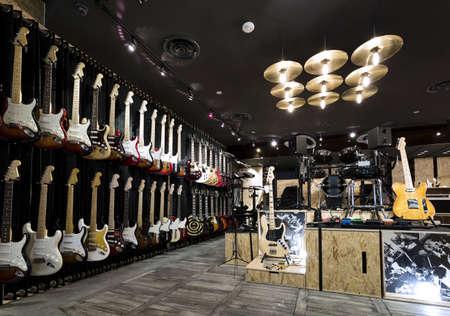 folk music: Horizontial shot of inside a musical instrument store.