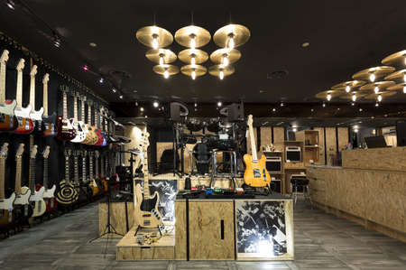Horizontial shot of inside a musical instrument store. photo