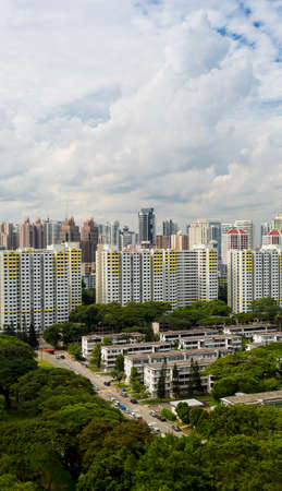 hdb: A high angle view of a low rise old residental estate with city as background