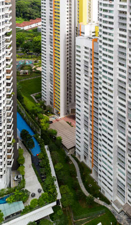 hdb: High angle view of a colorful neighborhood estate with swimming pool and carpark