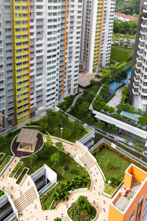 hdb: High angle view of a colorful neighborhood estate with swimming pool and roof garden