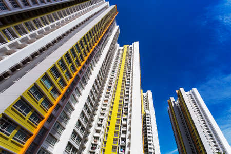 hdb: A low angle shot of a new colorful high rise apartment against the sky