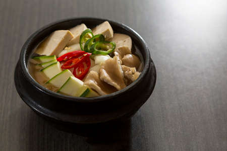 A heated stone bowl dish of korean vegetarian food