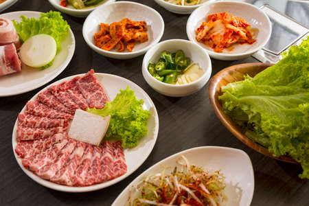 korean food: A horizontal shot of beef with korean side dishes