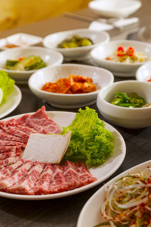 side of beef: A vertical shot of beef with korean side dishes