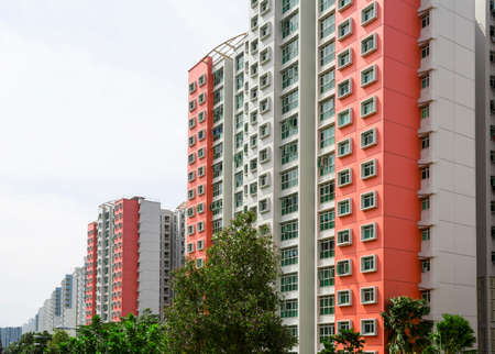 accommodation space: A row of red color housing apartment