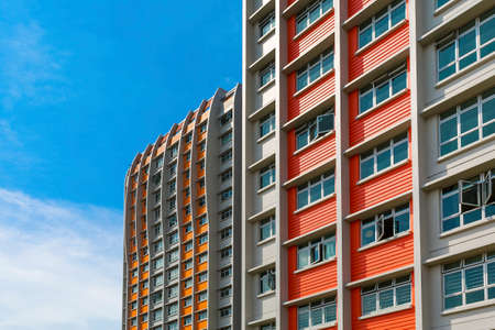 tall buildings: A close up shot of a new colorful high rise apartment against the sky  Stock Photo
