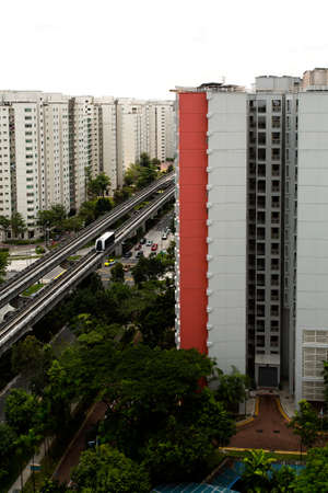 hdb: Vertical shot of a sky train and track system in a modern neighborhood