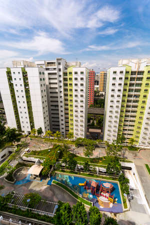 hdb: A high angle shot of a residential estate with roof facilities of garden and playground