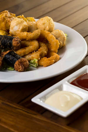 A vertical shot of a plate of fried finger food snack ready to be served   photo