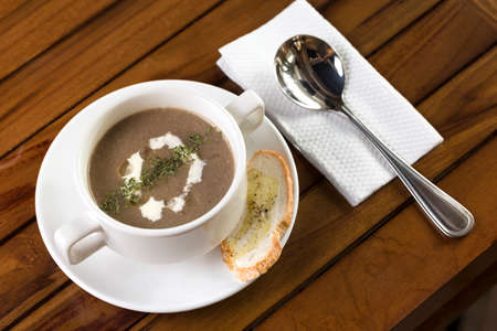 A cup of mushroom soup ready to be served