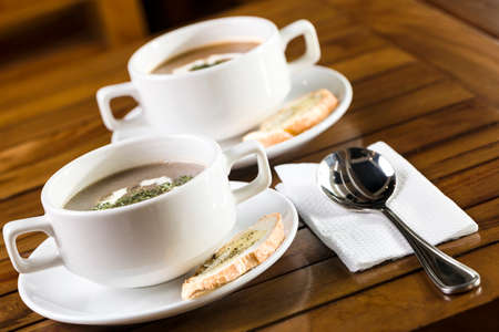 Two cups of mushroom soup ready to be served
