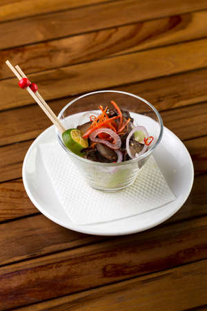 A glass of mushroom appetizer to be served