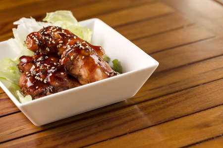 Barbecue buffalo wings with sesame sauce ready to be served.