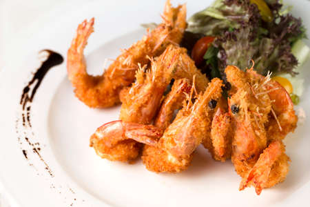 A close up plate of deep fried Prawns ready to be served.