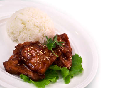 Pieces of sweet sour pork chop with rice