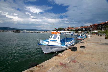 peer to peer: Boat near peer. Nesebar. Bulgaria.