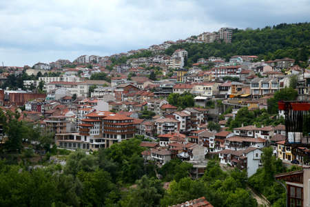European houses with brown tile roof on the hills and mountains. Veloko Tarnovo