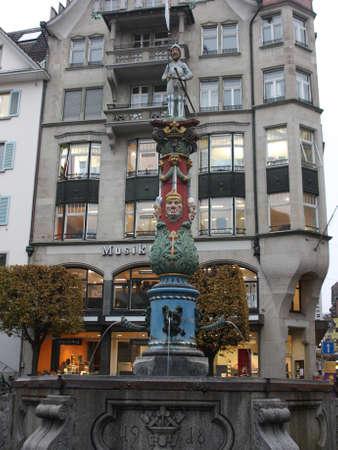 allegoric: Lucerne, Switzerland - Novembre 24 2016. look to Fritschi Fountain on Kapellplatz.