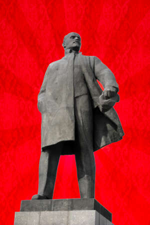 Monument to Vladimir Lenin - leader of the Russian revolution on red background