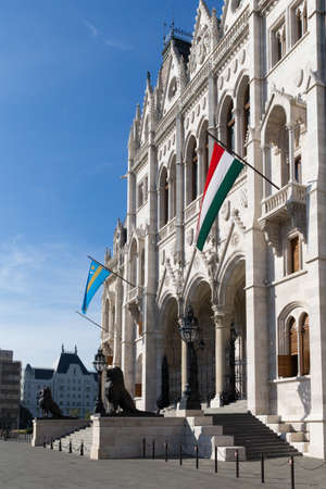 gabled: Beautiful view of Budapests Parliament. Parliament Building on the Danube River in Budapest. Hungary Budapest. View from garden to Parlament. Stock Photo