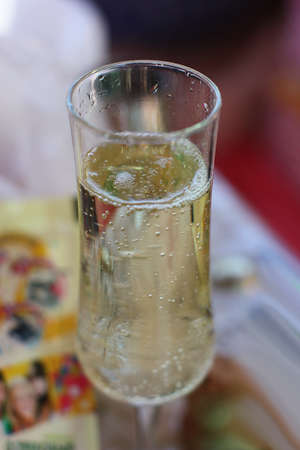 Elegant champagne glass with sparkles and bubbles. Blure background. 写真素材
