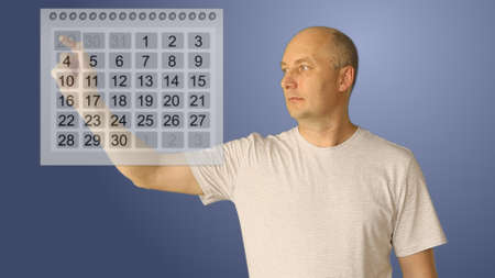Young bald man work with virtual calendar. Male choice two date for start and end period. Planing perioad for rest or for business plan. Gradient background dolly shot upper half close-up. Stockfoto