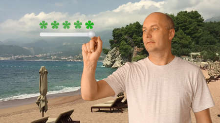 Feedback five stars from man on virtual screen. Man standing on sunny beach. Man move slider to set rating of services from one to five star. Caucasian man smiling and show thumbs up.