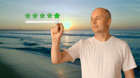 An adult man standing on the beach by the sea at sunset shows an excellent rating for the resort. A high score of 5 stars for the beach is long and beautiful.