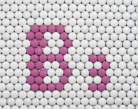 b: Vitamin B 3 made of tablets on background of pills