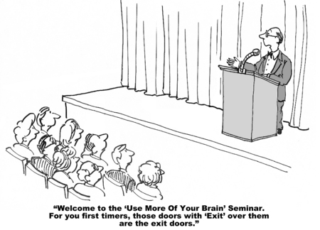 Cartoon of business seminar leader talking to audience, topic is: use more of your brain.