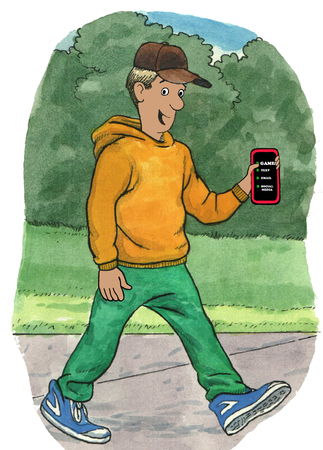 Teen boy holding his cell phone